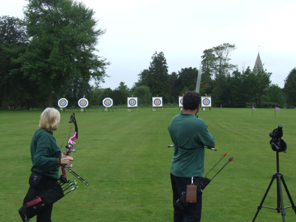 Archers drawing to fire.